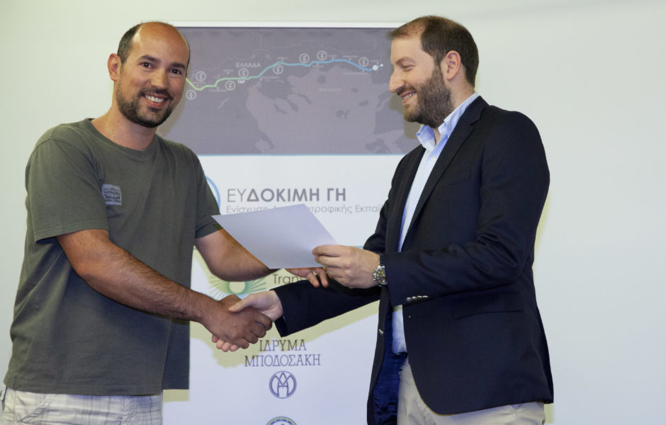 It's graduation day! M. Gkosliopoulos, TAP's Community Liaison Coordinator W. Macedonia, awards a degree to a beneficiary